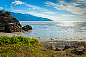 Scenic beach on Turnagain Arm under blue sky, Southcentral Alaska, Summer.