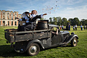 nuns distributing candy for the 80 years of the front-wheel drive 'traction avant', legendary car in the park of the chateau saint-simon, la ferte-vidame, eure-et-loir (28), france