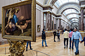 visitors in the hall of italian paintings, museum of the louvre, paris (75), france