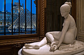 the nymph with the scorpion by lorenzo bartolini, hall of italian sculptures, marble sculpture in front of the facade and pyramid of the museum of the louvre, paris (75), france