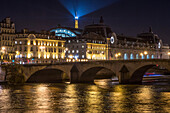 quays of the seine with the pont-royal bridge, the orsay museum (former orsay train station) and the eiffel tower lit up, paris (75), france