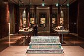 muslim tomb and display cases in one of the galleries of the museum of islamic art, doha, qatar, persian gulf, middle east