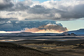 plateau of modrudalur, to the right the volcano herdubreid and to the left a cloud from the volcano bardabunga spewing out lava and toxic gasses (sulphur dioxide pollution) over northern europe, bardarbunga volcanic system, route f901, iceland, europe