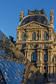 the louvre and its pyramid, situated in the heart of the city in the 1st arrondissement, it is one of the biggest museums in the world and the biggest in france, (75) paris, ile-de-france, france