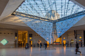the carrousel du louvre and its inverted pyramid, situated below the tuileries gardens, is both a shopping mall and cultural and historical space, (75) paris, ile-de-france, france