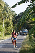 Tourist on main street of the island, connecting resorts on the east coast, near Beach No.3, Havelock Island, Andaman Islands, Union Territory, India