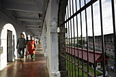 Cellular Jail, National Monument, visitors in the cellblock, overlooking the courtyard of the Colonial prison, Port Blair, South Andaman, Andaman Islands, India