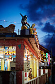 Decorated Hindu temple on Main Street Subhas Bazaar in the evening, priests, Diwali Festival of Lights on 02/11/13, large village Diglipur, North Andaman, Andaman Islands, Union Territory, India