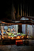 Greengrocer stall decorated with candles, on main street Subhas Bazaar, Divali Festival of Lights at 02/11/13, large village Diglipur, North Andaman, Andaman Islands, Union Territory, India