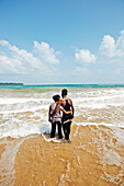 Couple in the water, Butler Bay Beach, uninhabited, East Coast, northern Can Hat Bay, Little Andaman, Andaman Islands, Union Territory, India