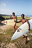 Surfer Thomas Arland, ''Motu', 38 Y., and his student Simhachalam, 18 Y., on the beach of Hat Bay, main town of Little Andaman, Andaman Islands, Union Territory, India