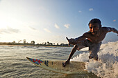 Surfer Thomas Arland, ''Motu', on the beach of Hat Bay, main town of Little Andaman, Andaman Islands, Union Territory, India