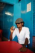 Artist and art teacher Suresh Kumar having tea in the best restaurant of Hut Bay: Siva Hotel, capital of Little Andaman, Andaman Islands, Union Territory, India