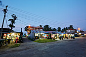Shops in the centre of the little Gandhi Bazaar, the tallest building is Sea Land Tourist Home, Hut Bay, main town of Little Andaman, Andaman Islands, Union Territory, India