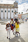 Pony rides on a plastic horse, Praca da Se, in front of Cathedral, historic center Pelourinho, Salvador de Bahia, Bahia, Brazil