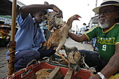 Men with chickens, weekly market Monday and Friday in the center of Andarai, eastern border of the Chapada Diamantina National Park, Andarai, Bahia, Brazil