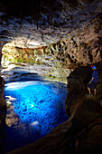 Poco Encantado, the enchanted pool, west of Andarai, cave is 100m high and has 48m deep water east of the Chapada Diamantina National Park, Andarai, Bahia, Brazil