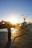 Helicopter rotors being cleaned with fresh water after helicopter flight, landing platform on Urca peninsula below the Sugar Loaf Mountain, Rio de Janeiro, Brazil
