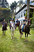 Horse riding for guests of Fazenda Catucaba, old farm from 1850 is now also a luxurious hotel, located in the coastal mountains, Parque Serra do Mar in Sao Luiz do Paraitinga, Sao Paulo, Brazil