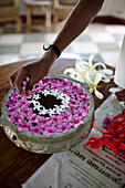 Floral decoration, instead of flower bouquets, blossoms are placed on the surface of the water in a bowl, Ayurvedic Hospital and luxury hotel Kalari Kovilakom, Kollengode, near Palakkad, Kerala, Western Ghats, India