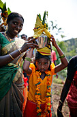 Girl carrying holy water to the temple, Sri Vinayagar temple festival, annual Hindu festival in the village of Nadukahni, northwest of the Nilgiri Hills (Ooty), Western Ghats, Tamil Nadu, India