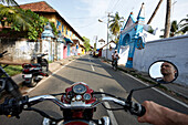 Photographer Hauke Dressler on a Royal Enfield motorcycle from 1986, Portuguese architecture along Bazaar Road in Fort Kochi, Cochin, Kerala, India