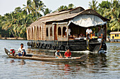Tourist boat, one of about 2000 on the canals of the backwaters, southeast Aleppey, Backwaters, Kerala, India