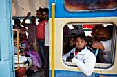 Passengers in the Nilgiri Mountain Railway, 2nd class compartment (General Compartment), in Conoor, Nilgiri Hills, Western Ghats, Tamil Nadu, India