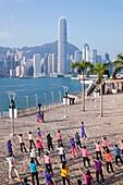 China,Hong Kong,Central,People Exercising and City Skyline