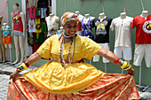 Brazilian woman wearing traditional clothes of the Bahia region in Salvador da Bahia, the city of the Holy Saviour of the Bay of all Saints on the northeast coast of Brazil , South America