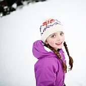 Portrait of a 5 years old little girl in the mountains, in winter