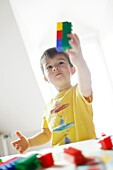 A boy playing with Lego
