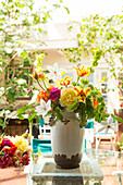Bouquet of flowers in vase on backyard patio