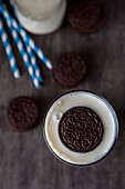 Oreo Cookie Floating in Glass of Milk, High Angle View