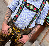 Man with tattoo in leather trousers, Lenggries, Bavaria, Germany