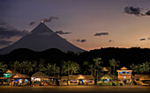Bars and restaurants with Mayon Volcano, crater glow, Legazpi City, Philippines, Asia