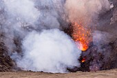 Look inside the active volcano Yasur during a lava eruption. Lava and emitting gases, Vanuatu, Tanna Island, South Pacific