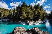 Rocks and trees around still remote lake