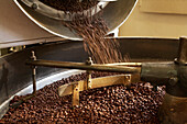Coffee beans roasting in industrial kettle