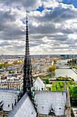 Notre Dame spire over Paris cityscape, Ile-de-France, France