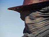 Close up of Caucasian traveler wearing face scarf