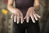Close up of chalky hands of athlete in gym
