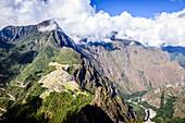 Aerial view of Macchu Picchu ruins in remote landscape, Cusco, Peru