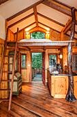 Doorway and loft bedroom in wooden tree house