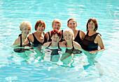 Older Caucasian women smiling in swimming pool