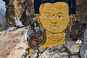 Close up of Buddha painting on rock formation, Chazam, Trongsa District, Bhutan
