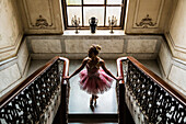 Hispanic ballet dancer standing on staircase