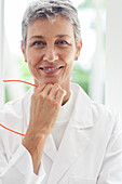 Close up of smiling doctor resting chin in hand
