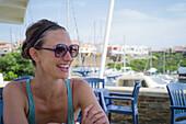 Caucasian woman smiling on restaurant patio