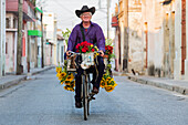 Hispanic florist riding bicycle